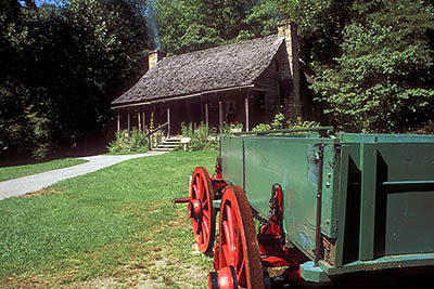 NC: Transylvania County, Pisgah National Forest, Davidson River Area, The Cradle of Forestry In America, Restored log cabin; wagon. Near Brevard [Ask for #188.026.]