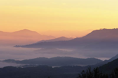 North Carolina: Central Mountains Region, Haywood County, The Blue Ridge Parkway, The Balsam Mountains (South Section), Waynesville Overlook, MP 441, Dawn view over Waynesville, with valley fog and sunrise colors [Ask for #237.512.]
