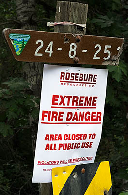 OR: South Coast Region, Douglas County, Coast Range, Reedsport Area, Camp Creek Area (BLM), Tyee Area, Poster on a BLM road sign warns of fire danger [Ask for #274.641.]