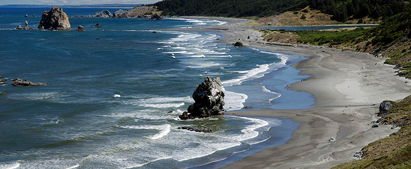OR: South Coast Region, Curry County, North Coast, Cape Blanco Area, Cape Blanco State Park, View of Cape Blanco with its quiet, protected beach, large hoodoos, and grass-topped cliffs [Ask for #274.681.]