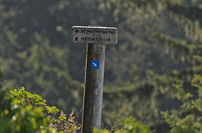 OR: South Coast Region, Lane County, Pacific Coast, Cape Perpetua Area, Cape Perpetua National Scenic Area, Cape Perpetua Overlook, Wood trail sign gives directions for St. Perpetua Trail [Ask for #276.A01.]