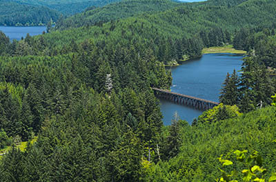 A wide view of Lake Tahkenich, with the Coos Bay Rail Link trestle